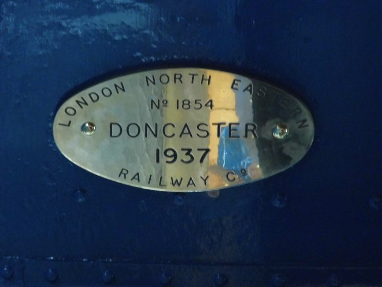 Builder's plaque of Dominion of Canada relocated to original position inside the cab.