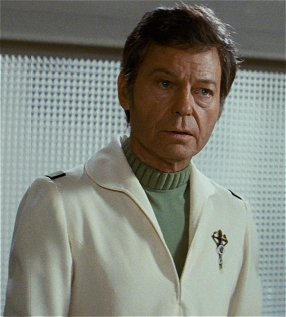 McCoy models the senior medical uniform seen in ST II